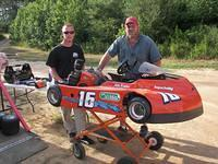 John Fowler with Kendall Barnes from Sedly, VA in their Griffin Oil & Propane Phenom kart won 1st place in Stock Medium 6-25